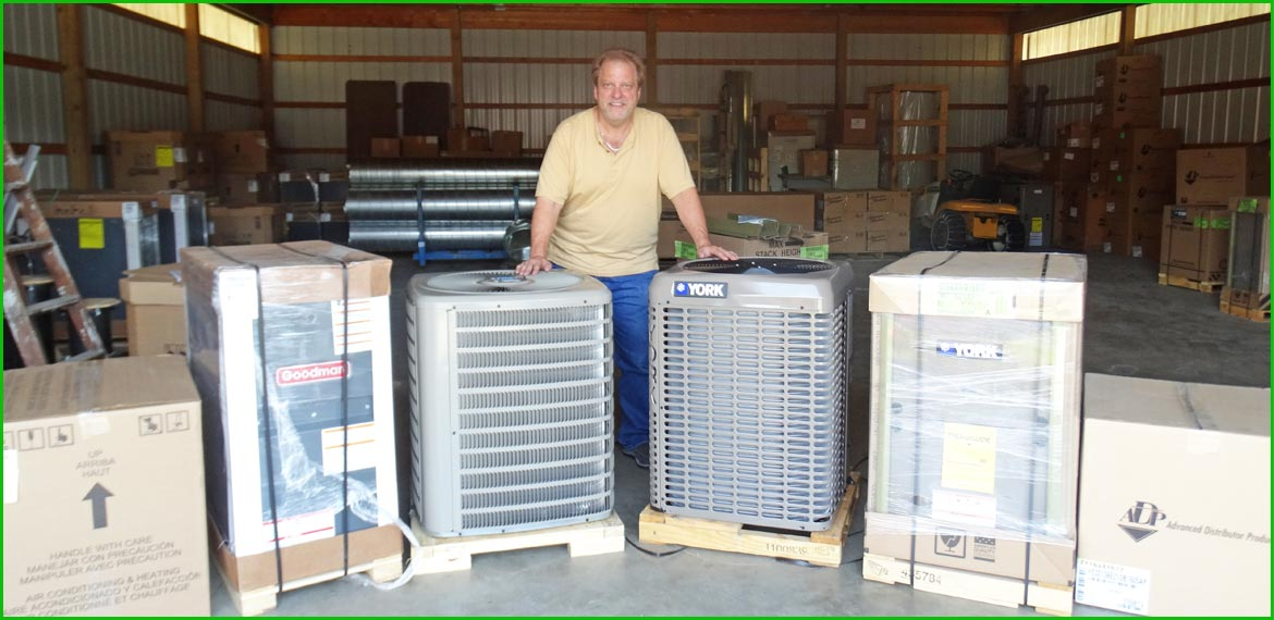 Man beside AC units in a warehouse
